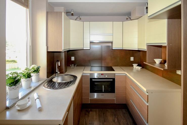 9. Изогнутые угловые кухонные шкафы.